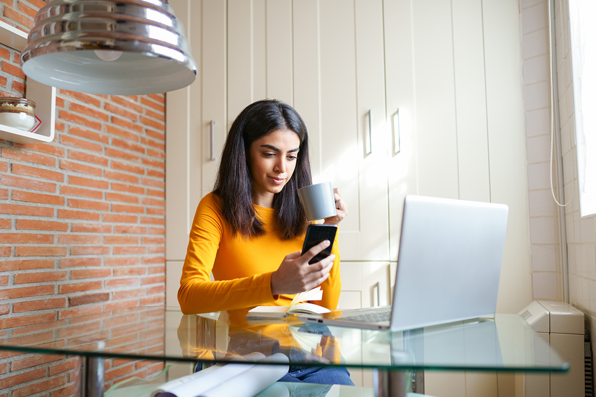 female architect working at home with a laptop and 3XMFK9U